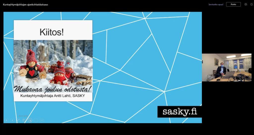 Kuva etäkokouksesta, ruudulla teksti kiitos ja mukavaa joulun odotusta sekä jouluinen kuva.